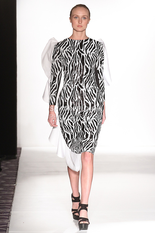 Model walks runway in an outfit from the J. Loren Fall 2015 collection, during the Accessories Premier Fall Winter 2015 fashion show for  Fashion Gallery New York Fashion Week Fall 2015.
