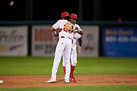 Orem Owlz infielders Jeremiah Jackson (23) and Jose Quezada (1) celebrate a victory after a Pioneer League game against the Idaho Falls Chukars at The Home of the OWLZ on August 13, 2019 in Orem, Utah. Orem defeated Idaho Falls 3-1. (Zachary Lucy/Four Seam Images)