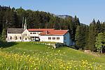 Austria, Tyrol, Tirol, Rettenschoess near Walchsee: springtime at Kaiserwinkl region, municipal office and primary school Harland