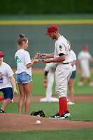 Great Lakes Loons first baseman Justin Yurchak (24) signs an autograph for a young fan before a Midwest League game against the Clinton LumberKings on July 19, 2019 at Dow Diamond in Midland, Michigan.  Clinton defeated Great Lakes 3-2.  (Mike Janes/Four Seam Images)