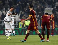 Juventus' Mario Mandzukic, left, celebrates as Roma's players react at the end of the Italian Serie A football match between Juventus and Roma at Juventus Stadium. Juventus won 1-0.