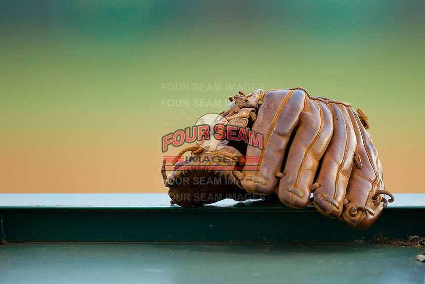 A baseball glove sits on top of the Bandys Trojans dugout during their baseball game against the South Iredell Vikings at Bandys High School on March 22, 2013 in Catawba, North Carolina.  (Brian Westerholt/Four Seam Images)