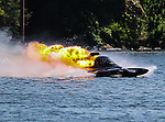Kebin Kinsley, driver of the Hot Licks Top Fuel Drag boat, suffering an engine explosion at the Marble Falls Lakefest Drag Boat Races.