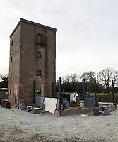BNPS.co.uk (01202 558833)<br /> Pic: OnTheMarket/BNPS.<br /> <br /> Start of the restoration...<br /> <br /> A historic World War Two POW water tower has emerged on the market for £1.2million after being converted into a modern family home.<br /> <br /> The original red brick structure was once part of 78 Working Camp, which housed 700 Italian and German prisoners in the Essex countryside near Braintree.<br /> <br /> It doubled as a secret communications hub, sending early warning signals of enemy aircraft to Wethersfield, an American airbase five miles away.   <br /> <br /> The derelict tower, dating from 1938, and one acre plot in High Garrett, near Braintree, were bought by Jon Oakley and his wife Vicky for £285,000 in 2017. It had been unused since 1950.<br /> <br /> They have spent several hundred thousand pounds converting it into a five storey home with four en-suite bathrooms and a ground floor extension. A top level has been added to the 50ft structure to replace the water tank which was removed following the war.