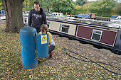 Houseboat on the River Lea, Hackney, London. Refilling a water tank at Lee Valley Marina.