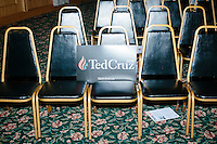 A campaign sign lays on empty seats after Texas senator and Republican presidential candidate Ted Cruz spoke at a town hall at The Alpine Grove banquet center in Hollis, New Hampshire.