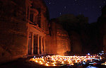 View of Al Khazneh during a candlelight tour in the ancient Jordanian city of Petra. Petra is the most visited tourist attraction in Jordan, a symbol of the country for its historical and archaeological importance. It has been a UNESCO World Heritage Site since 1985.
