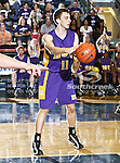 Hardin-Simmons Cowboys forward Ryan Carlson (11) passes the ball in the game between the UTA Mavericks and the Hardin-Simmons Cowboys held at the University of Texas in Arlington's Texas Hall in Arlington, Texas. UTA defeats Hardin-Simmons 88 to 71.