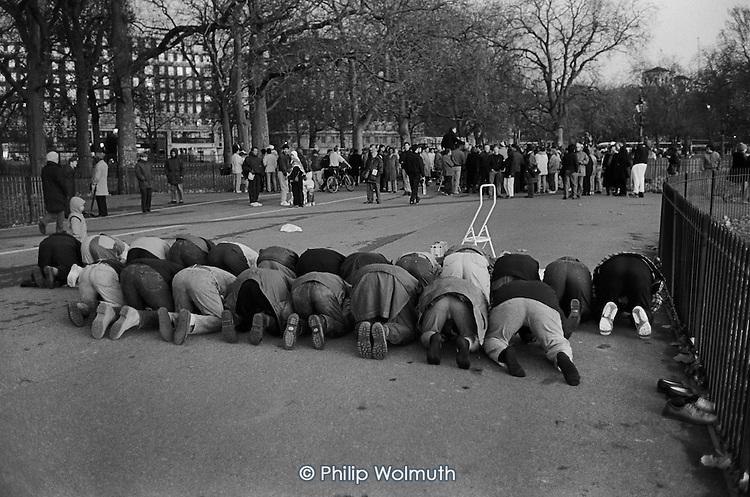 Muslims pray at dusk.  Speakers' Corner, Hyde Park, London.