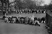 Muslims pray at dusk.  Speakers' Corner, Hyde Park, London.