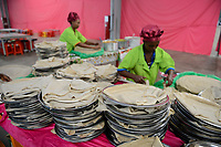 ETHIOPIA , Southern Nations, Hawassa or Awasa, Hawassa Industrial Park, chinese-built for the ethiopian government to attract foreign investors with low rent and tax free to establish a textile industry and create thousands of new jobs, taiwanese company Everest Textile Co. Ltd. , canteen, injera lunch for the workers, injera is the traditional bread from Teff flour / AETHIOPIEN, Hawassa, Industriepark, gebaut durch chinesische Firmen fuer die ethiopische Regierung um die Hallen fuer Textilbetriebe von Investoren zu vermieten, taiwanesische Firma Everest Textile Co. Ltd., Kantine, Mittagessen fuer die Arbeiter, Injera aus Tef Mehl