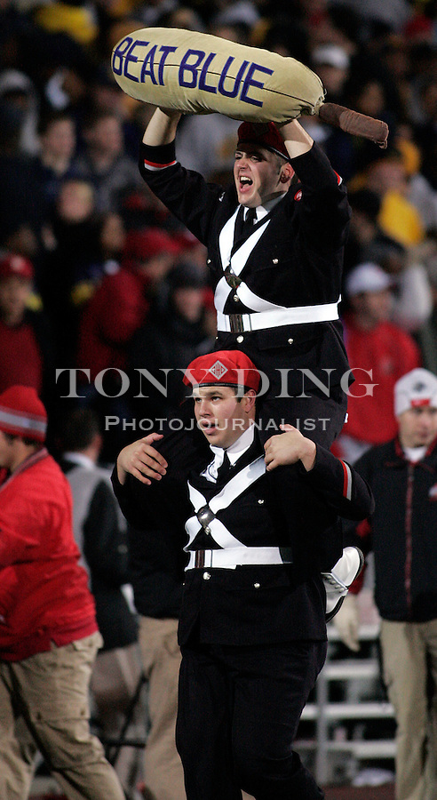 """18 Nov 2006: Ohio State band members run a sack labled """"BEAT BLUE"""" piggy-back across the field in celebration of an OSU touchdown, during Ohio State's 42-39 win over Michigan in a college football game at Ohio Stadium in Columbus, OH."""