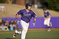 Catcher John Michael Boswell (8) of the Furman Paladins runs out a batted ball in game two of a doubleheader against the Harvard Crimson on Friday, March 16, 2018, at Latham Baseball Stadium on the Furman University campus in Greenville, South Carolina. Furman won, 7-6. (Tom Priddy/Four Seam Images)