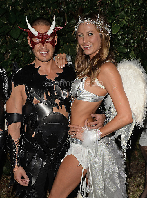 MIAMI BEACH, FL - NOVEMBER 01: (EXCLUSIVE COVERAGE) Stacy Keibler may have split from the world's most sought after man, George Clooney, but the former wrestler has certainly landed on her feet. Stacy Keibler's and her new boyfriend tech millionaire Jared Pobre attended Real Housewives of Miami's Lisa Hochstein and husband plastic surgeon Lenny Hochstein's private annual Halloween ball to benefit make a wish foundation.  Stacy Ann-Marie Keibler is an American actress, model, and retired professional wrestler and valet, best known for her work with World Championship Wrestling and World Wrestling Entertainment on Star Island On November 1, 2013 in Miami Beach, Florida.<br /> <br /> <br /> People:  Stacy Keibler_Jared Pobre<br /> <br /> Transmission Ref:  FLXX<br /> <br /> Must call if interested<br /> Michael Storms<br /> Storms Media Group Inc.<br /> 305-632-3400 - Cell<br /> 305-513-5783 - Fax<br /> MikeStorm@aol.com