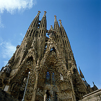 The soaring bell towers and ornately adorrned nativity entrance of Gaudi's Sagrada Familia cathedral