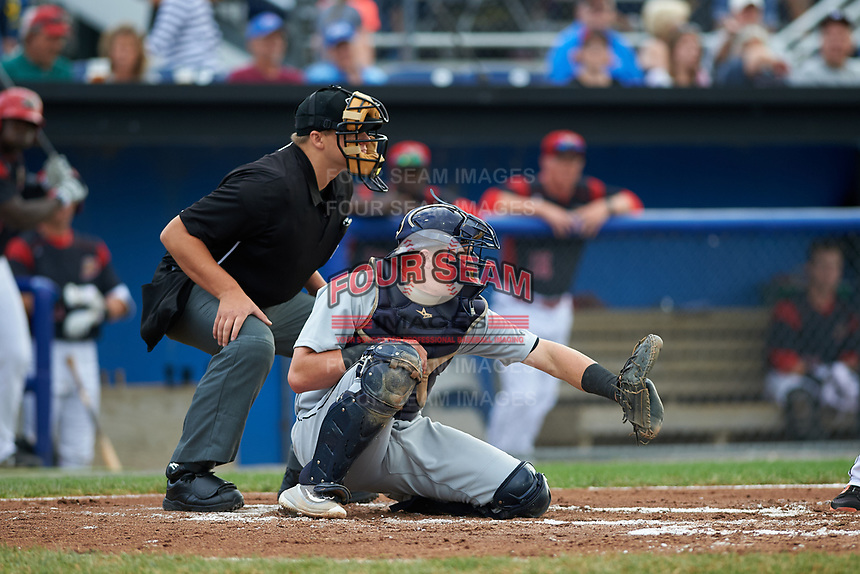 Umpire John Boccio and Tri-City ValleyCats catcher Michael Papierski (9) await the pitch during a game against the Batavia Muckdogs on July 14, 2017 at Dwyer Stadium in Batavia, New York.  Batavia defeated Tri-City 8-4.  (Mike Janes/Four Seam Images)