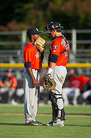 Greeneville Astros catcher Jacob Nottingham (27) has a chat with relief pitcher Angel Heredia (41) during the game against the Burlington Royals at Burlington Athletic Park on June 29, 2014 in Burlington, North Carolina.  The Royals defeated the Astros 11-0. (Brian Westerholt/Four Seam Images)