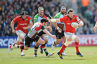Peter O'Mahony of Munster Rugby accelerates past Tom Casson of Harlequins during the Heineken Cup quarter final match between Harlequins and Munster at the Twickenham Stoop on Sunday 7th April 2013 (Photo by Rob Munro)