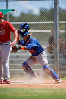 GCL Mets catcher Jose Mena (38) tracks down a loose ball during a game against the GCL Cardinals on August 6, 2018 at Roger Dean Chevrolet Stadium in Jupiter, Florida.  GCL Cardinals defeated GCL Mets 6-3.  (Mike Janes/Four Seam Images)