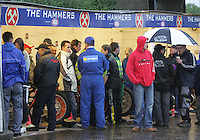 Riders, mechanics and track staff take shelter in the pits area - Arena Essex vs Oxford Cheetahs - Elite League 'A' - Meeting Abandoned - 24/05/06 - (Gavin Ellis 2006)