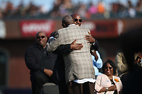 SAN FRANCISCO, CA - AUGUST 11:  Former San Francisco Giants player Barry Bonds hugs Dusty Baker during the ceremony to retire his #25 jersey before the game between the Pittsburgh Pirates and San Francisco Giants at AT&T Park on Saturday, August 11, 2018 in San Francisco, California. (Photo by Brad Mangin)