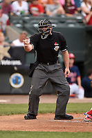Home plate umpire Spencer Flynn during a game between the Oklahoma City RedHawks and Memphis Redbirds on May 23, 2014 at AutoZone Park in Memphis, Tennessee.  Oklahoma City defeated Memphis 12-10.  (Mike Janes/Four Seam Images)