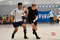 Nic Allen of Wellington College and Vincent Phirun of Tauranga Boys College battle for the ball during the NZ Secondary Schools Senior Boys Final between Wellington College and Tauranga Boys' College at ASB Sports Centre, Wellington on 26 March 2021.<br /> Copyright photo: Masanori Udagawa /  www.photosport.nz