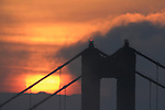 The sunrise over the northtower of the Golden Gate Bridge as seen from Hawk Hill, Marin Headlands.