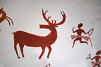 Recontructed fresco of an original found at Catalhoyuk. The hunters are believed by scholors to be wearing leopard skin costumes, Painted by Mutlu Gundiler. Reconstructed houses, 7500 BC to 5700 BC, Catalyhoyuk Archaeological Site, Çumra, Konya, Turkey