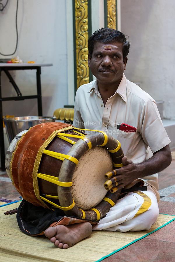 Player Playing Thavil, a South Indian Drum, Hindu Temple, Sri Maha Mariamman, Navarathri Celebrations, George Town, Penang, Malaysia.