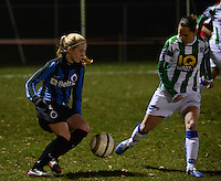 20131213 - VARSENARE , BELGIUM : Brugge's Silke Demeyere (left) pictured with Zwolle's Marije Brummel (right) during the female soccer match between Club Brugge Vrouwen and PEC Zwolle Ladies , of  matchday 14  in the BENELEAGUE competition. Friday 13th December 2013. PHOTO DAVID CATRY