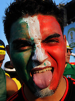 A Mexico supporter makes a gest during a live broadcast of the soccer World Cup match between Brazil and Mexico on Copacabana beach, Rio de Janeiro, Brazil, June 17, 2014