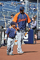 Apr 02, 2011; Bronx, NY, USA; Detroit Tigers catcher Victor Martinez (41) and his son before game against the New York Yankees at Yankee Stadium. Yankees defeated the Tigers 10-6. Mandatory Credit: Tomasso De Rosa