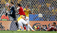 FORTALEZA - BRASIL -04-07-2014. Foto: Roberto Candia /Archivolatino<br /> David Ospina (#1) arquero de Colombia (COL) se apodera del balón en una jugada apoyado de Mario Yepes (#3) mientras Fred (#9) y Neymar (#10) jugadores de Brasil (BRA) obstruyen durante partido de los cuartos de final por la Copa Mundial de la FIFA Brasil 2014 jugado en el estadio Castelao de Fortaleza./ David Ospina (# 1) goalkeeper of Colombia (COL) takes possession of the ball in a move supported by Mario Yepes (# 3) while Fred (# 9) and Neymar (# 10) players from Brazil (BRA) during obstruct the match of the Quarter Finals for the 2014 FIFA World Cup Brazil played at Castelao stadium in Fortaleza. Photo: Roberto Candia /Archivolatino<br /> VizzorImage PROVIDES THE ACCESS TO THIS PHOTOGRAPH ONLY AS A PRESS AND EDITORIAL SERVICE IN COLOMBIA AND NOT IS THE OWNER OF COPYRIGHT; ANOTHER USE IS REPONSABILITY OF THE END USER. NO SALES, NO MERCHANDASING. ALL COPYRIGHT IS ARCHIVOLATINO