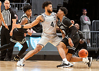 WASHINGTON, DC - FEBRUARY 19: Jagan Mosely #4 of Georgetown blocks the progress of A.J. Reeves #10 of Providence during a game between Providence and Georgetown at Capital One Arena on February 19, 2020 in Washington, DC.
