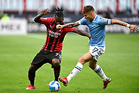 Franck Kessie of AC Milan and Ciro Immobile of SS Lazio compete for the ball during the Serie A 2021/2022 football match between AC Milan and SS Lazio at Giuseppe Meazza stadium in Milano (Italy), August 29th, 2021. Photo Image Sport / Insidefoto