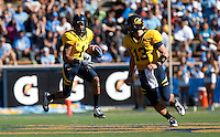 Marvin Jones (1) makes the run for the touchdown behind quarterback Kevin Riley (13). The California Golden Bears defeated the UCLA Bruins 35-7 at Memorial Stadium in Berkeley, California on October 9th, 2010.