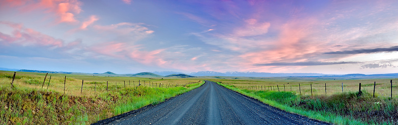 Road in Zumwalt Prairie with Wallowa Mountains. Oregon