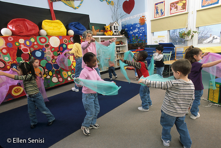 MR/Schenectady, New York.Yates Arts Magnet School / pre-K class.Students and teachers move to music with gauzey scarves..MR: LC-PK.FC#: 23048-00608.©Ellen B. Senisi