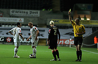Pictured: Bobby Hassell sees a yellow card from referee G D Horwood (R) for his foul on Thomas Butler (2nd L<br /> Re: Coca Cola Championship, Swansea City FC v Barnsley at the Liberty Stadium. Swansea, south Wales, Tuesday 09 December 2008.<br /> Picture by D Legakis Photography / Athena Picture Agency, Swansea 07815441513