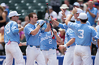Tyler Lynn (14) of the North Carolina Tar Heels celebrates with his teammates after hitting a home run against the Florida State Seminoles during the 2017 ACC Baseball Championship Game at Louisville Slugger Field on May 28, 2017 in Louisville, Kentucky.  The Seminoles defeated the Tar Heels 7-3.  (Brian Westerholt/Four Seam Images)