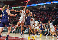 COLLEGE PARK, MD - JANUARY 26: Stephanie Jones #24 and Ashley Owusu #15 of Maryland defend against Sydney Wood #3 of Northwestern during a game between Northwestern and Maryland at Xfinity Center on January 26, 2020 in College Park, Maryland.