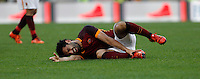 Calcio, Serie A: Roma vs Lazio. Roma, stadio Olimpico, 8 novembre 2015.<br /> Roma's Mohamed Salah lies on the pitch after getting injured during the Italian Serie A football match between Roma and Lazio at Rome's Olympic stadium, 8 November 2015.<br /> UPDATE IMAGES PRESS/Isabella Bonotto