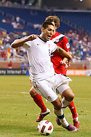7 June 2011: USA Men's National Team forward Clint Dempsey (8) falls during the CONCACAF soccer match between USA and Canada at Ford Field Detroit, Michigan. USA won 2-0.