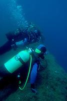 Two scuba divers looking deep down into the ocean near Ile de Riou, Marseille, France.