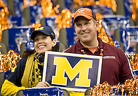 Michigan fan wife roots for Michigan while Virginia Tech fan husband roots for Virginia Tech during Sugar Bowl game at Mercedes-Benz SuperDome in New Orleans, Louisiana on January 3rd, 2012.  Michigan defeated Virginia Tech, 23-20 in first overtime.