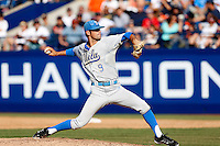Adam Plutko #9 of the UCLA Bruins pitches against the Cal State Fullerton Titans during the NCAA Super Regional at Goodwin Field on June 7, 2013 in Fullerton, California. UCLA defeated Cal State Fullerton, 5-3. (Larry Goren/Four Seam Images)