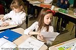 Education Elementary school Grade 2 two girls at desks organizing work horizontal