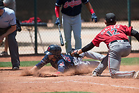 Cleveland Indians catcher Micael Ramirez (2) safely slides under the tag of pitcher Melvin Ovalles (12) during an Extended Spring Training game against the Arizona Diamondbacks at the Cleveland Indians Training Complex on May 27, 2018 in Goodyear, Arizona. (Zachary Lucy/Four Seam Images)