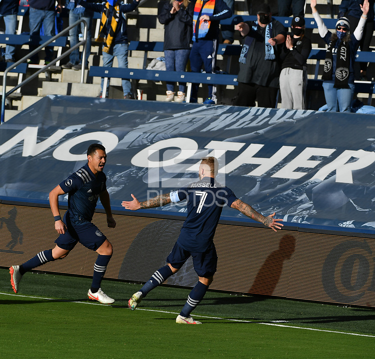 KANSAS CITY, KS - NOVEMBER 22: Roger Espinoza #15 and Johnny Russell #7 of Sporting KC celebrate Roger's goal at the beginning of the game before a game between San Jose Earthquakes and Sporting Kansas City at Children's Mercy Park on November 22, 2020 in Kansas City, Kansas.